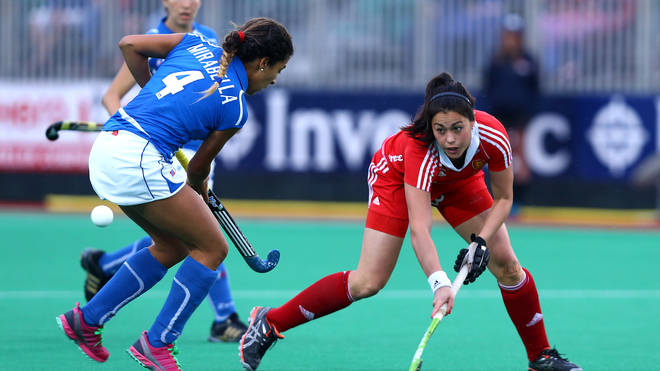 Sam Quek of England battles with Dalila Mirabella of Italy during the Investec Hockey World League quarterfinal match in London, 2013.