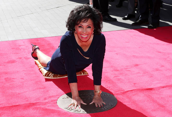 Dame Shirley Bassey places her hands into her handprints in a bronze plaque in Wembley Park's 'Square of Fame' at London's Wembley Arena in September 2019