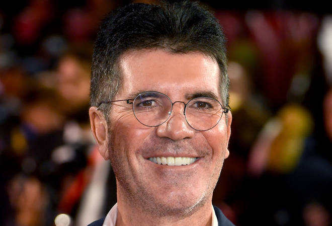 Simon Cowell is in hospital after breaking his back falling off a bike as his Malibu, California home.