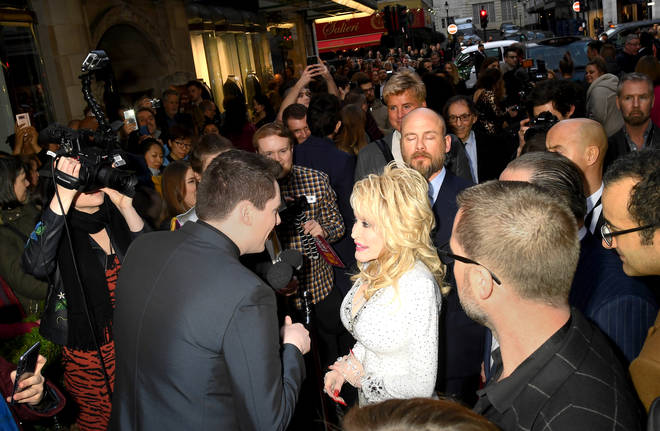 Dolly Parton being interviewed on the red carpet in London