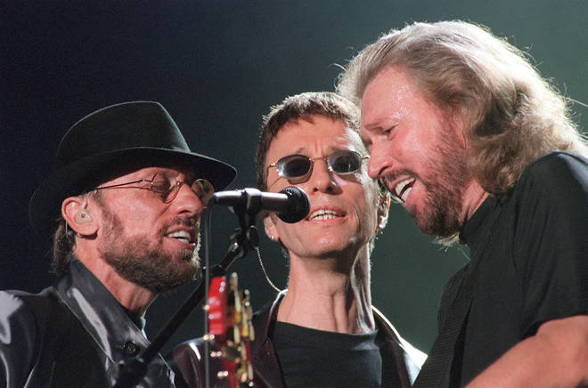 """The Bee Gees perform during the """"One Night Only"""" concert at Stadium Australia in Sydney, Australia, 1999."""