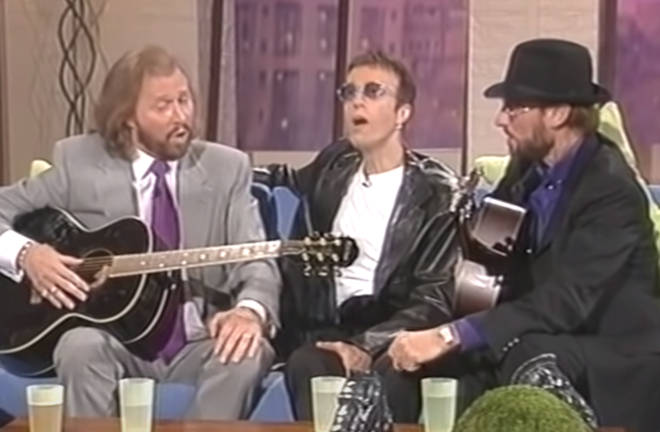 The Bee Gees gave an incredible acapella performance of 'How Deep Is Your Love' on a chat show. Pictured (L to R) Barry, Robin and Maurice Gibb. in 1998