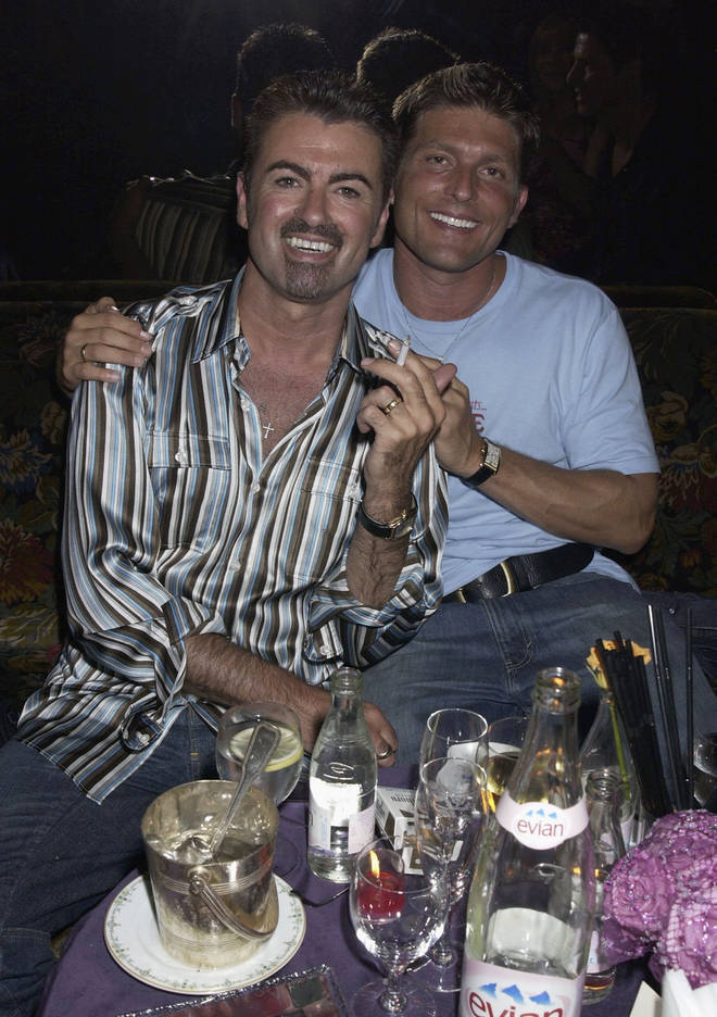 George Michael and partner Kenny Goss attend a party at The Ritz Hotel on 9th July 2002, in Paris