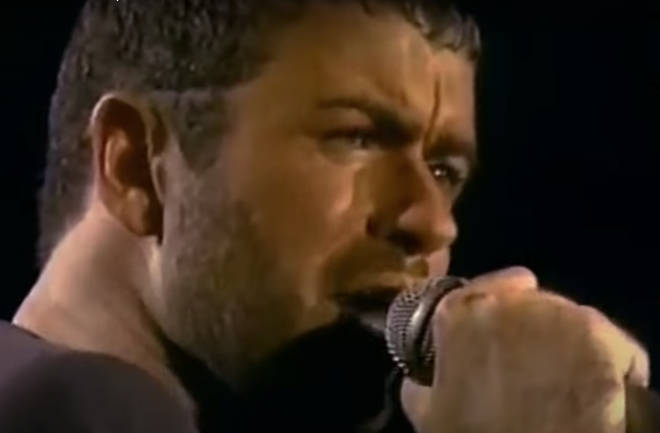 George Michael continues to look at the right-hand side of the stage where Anselmo is reportedly standing