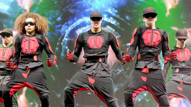 Ashley Banjo and Perri Luc Kiely of dance troupe Diversity perform at MEN Arena on April 9, 2012 in Manchester, England.