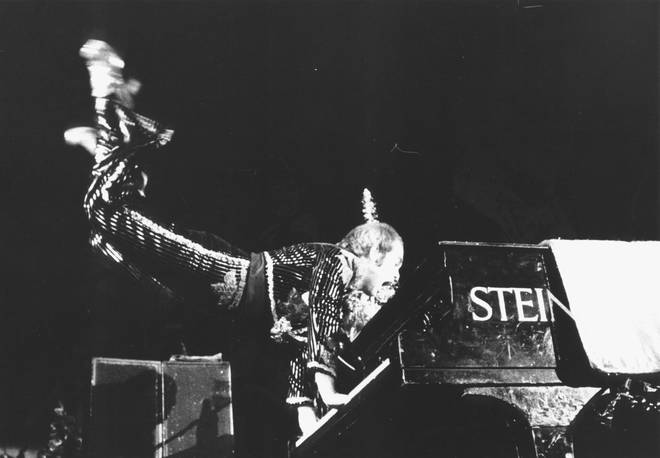 Elton John recreating his famous levitating act from the Troubadour at the Christmas Show in Hammersmith in 1974
