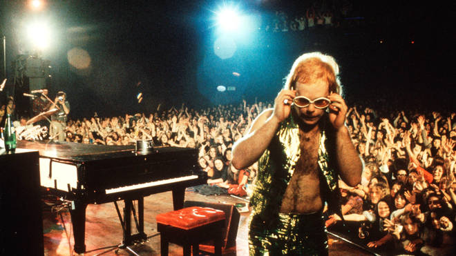 """The energy I put into my performance, kicking out my piano stool and smashing my legs down on the piano, caught everyone off guard. It was pure rock 'n' roll serendipity,"" Elton John said of his Troubadour gig. Pictured on stage circa 1974."