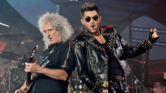 Musician Brian May and singer Adam Lambert perform at the Forum on July 3, 2014 in Inglewood, California.