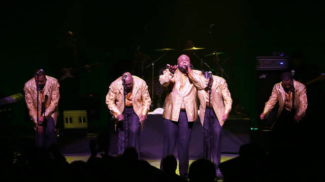Singer Bruce Williamson performing with The Temptations