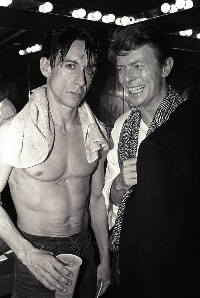 Great friends Iggy Pop and David Bowie pose backstage after Pop's concert at the Ritz, New York, New York, 1986.