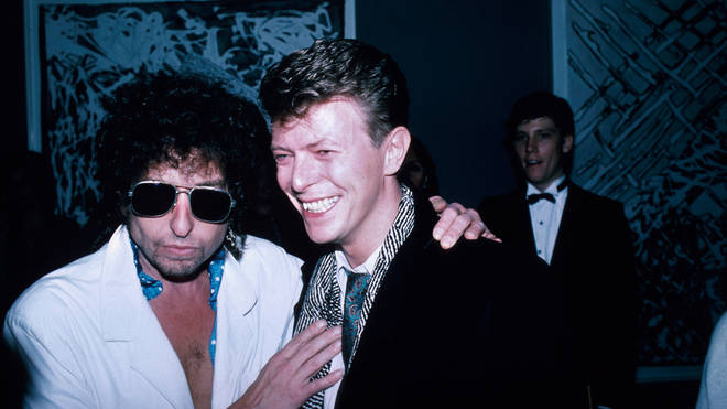 Recorded at Shepherd's Bush Studios David Bowie can be heard mimicking a collection of his close friends as he messes around in the recording booth. Pictured with Bob Dylan