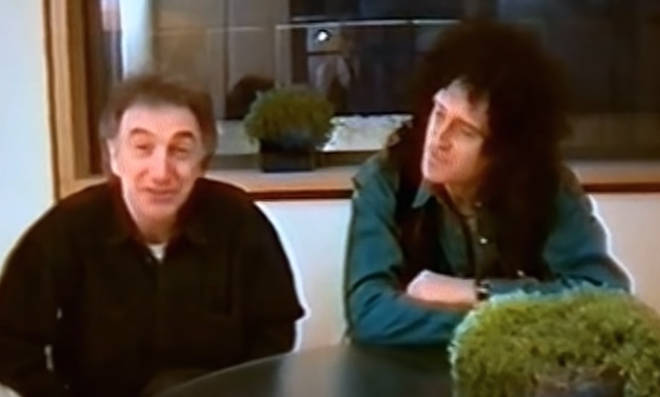 Queen's bassist can be seen sitting beside Brian May in the footage filmed in a recording studio in Chiswick, London.