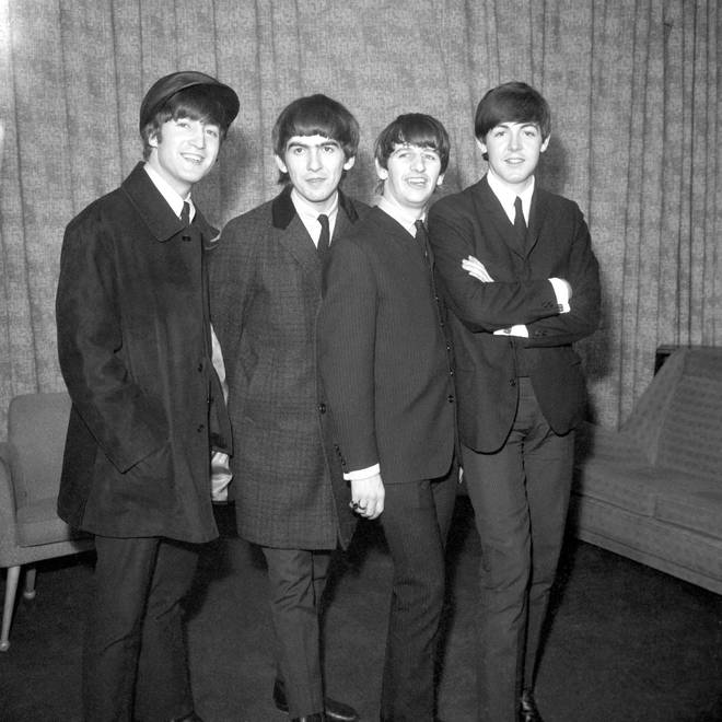John Lennon [far left] and his bandmates in The Beatles