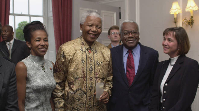Sir Trevor McDonald has split from his wife Josephine after 34 years of marriage. Pictured with wife Jo, far right, and Nelson Mandela, centre left, in 2001.