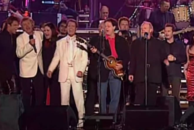 Brian May, Roger Taylor, Paul McCartney, Rod Stewart were joined by Phil Collins, Brian Wilson, Cliff Richard and Joe Cocker for an epic rendition of the Beatles classic 'All You Need Is Love', on June 4, 2002.