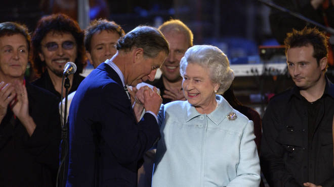 """Prince Charles joined the musicians on stage to pay tribute to his """"Mummy"""" and give her a kiss on the hand. Pictured, The Queen and Prince Charles, June 2, 2002"""