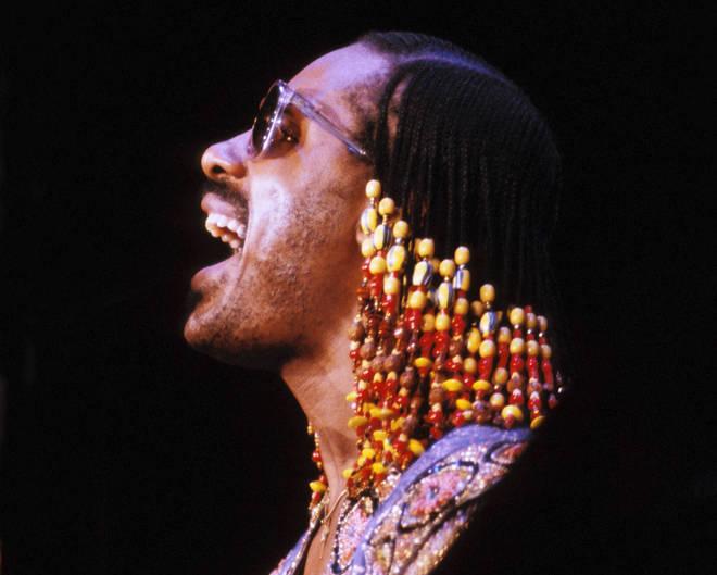 Stevie Wonder singing on stage in 1980