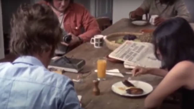 The footage then cuts to the incredible moment the fan is invited into the house and is filmed sitting at the dining room table with John and Yoko, while they all eat a meal together.