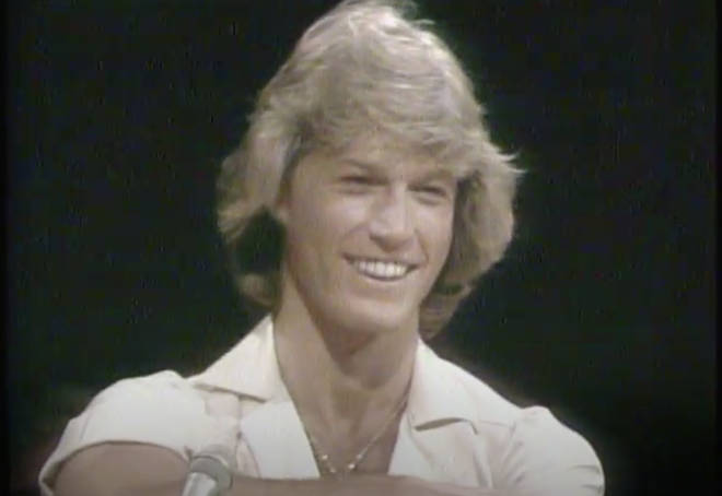 """Andy Gibb and Olivia Newton-John joke during """"jamming session"""" with ABBA for TV special in 1970s"""