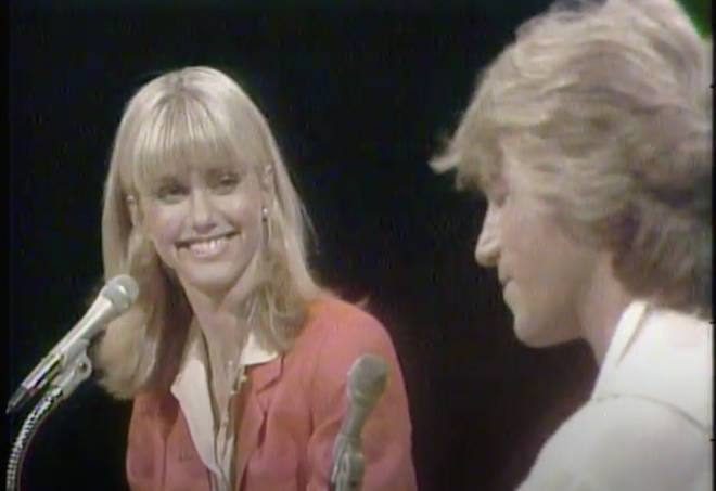 """Olivia Newton-John smiles at Andy Gibb as they perform """"jamming session"""""""
