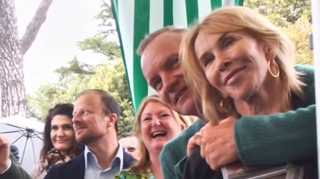 Sting and wife Trudie Styler, whose vineyard grounds the festival was taking place in, are seen standing in the audience and encouraging the singer as she starts to perform the iconic song.