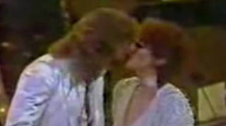 Bee Gees star Barry Gibb and singing sensation Barbra Streisand were presenting a Grammy Award when the Australian sex symbol gently kissed the Funny Girl star as the world watched on.