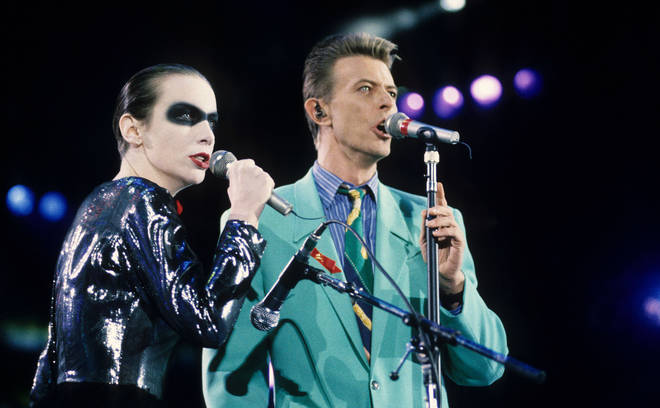David Bowie and Annie Lennox sing 'Under Pressure' on stage together at Freddie Mercury tribute concert