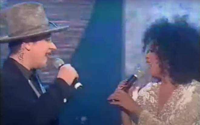 Inviting 'Georgie' on stage, the star launches into 'Upside Down' as a clearly delighted Boy George looks on, surprising her as he joins in with a word perfect rendition of the song.