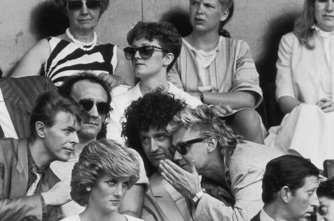 David Bowie, Roger Taylor and Brian May chatting during the Live Aid Concert at Wembley Stadium