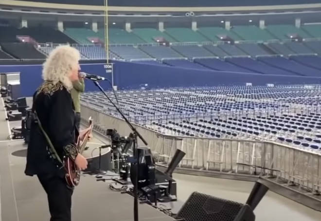 Brian May playing his guitar to thousands of empty seats, accompanied by Roger Taylor on the drums and Adam Lambert on vocals, is not something you see everyday.