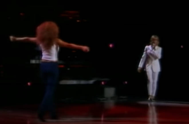 What fans didn't know was that the song's original performer, Olivia Newton-John, was waiting in the wings and ready to walk on stage to meet Mariah for a stunning one-off duet of the famous hit.