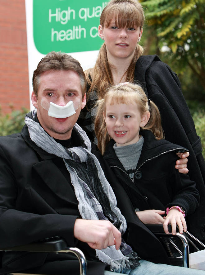 Russell Watson leaves hospital with daughters Rebecca and Hannah in 2007