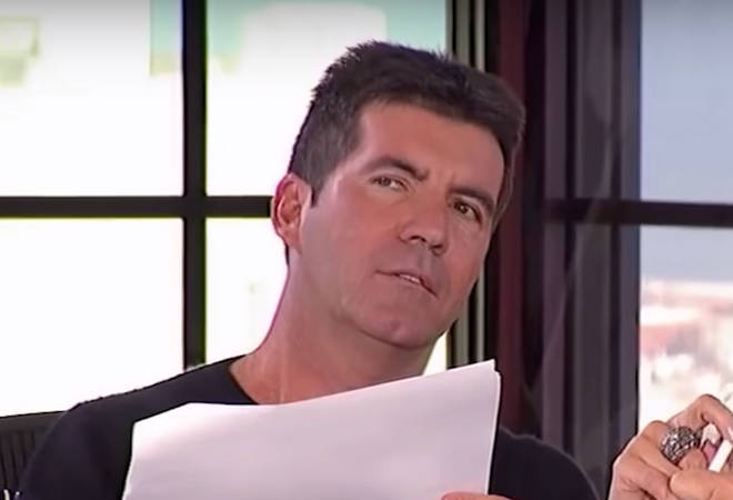 "Simon Cowell, Randy Jackson, Paula Abdul, and Kara DioGuardi then proceeded to argue over the young performers vocals, with Simon Cowell calling his performance ""too theatrical"""