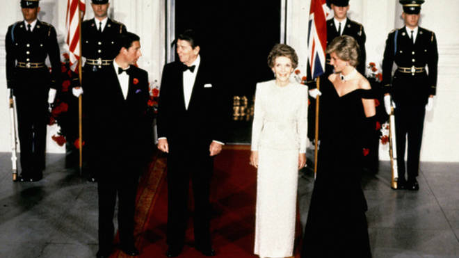 """""""Nancy and [Ronald] Reagan set up the press to take a picture of her dancing with John Travolta,"""" Paul Burrell later revealed. Pictured, Diana and Charles arriving at the 1985 gala dinner, accompanied by the Reagans."""