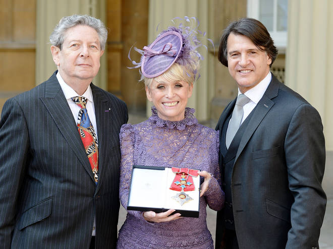 """Her husband Scott Mitchell (pictured right with the star when she was made a Dame in 2016) said she would be remembered for the """"love, fun, friendship and brightness she brought to all our lives""""."""