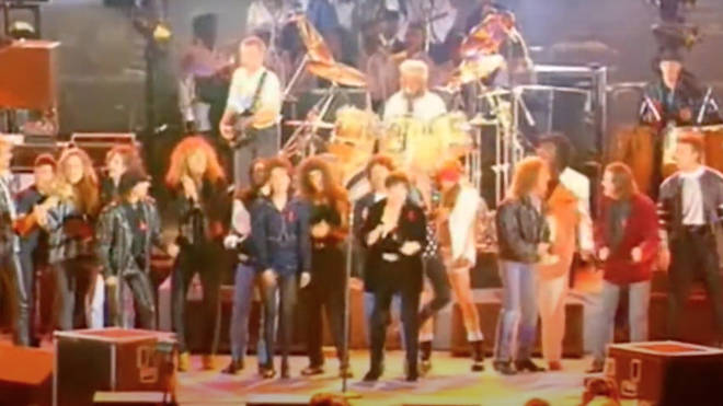 Stars including Lisa Stansfield, Seal, George Michael, Paul Young, Axl Rose and Slash line up to sing 'We Are The Champions'