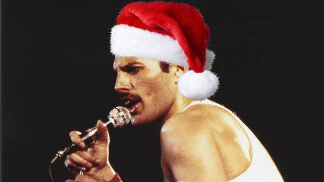 The special recording from 1977 captures the atmospheric audio of Queen's Freddie and Brian May performing an acoustic version of the festive classic to the audience in Inglewood, California. (Pictured, Freddie Mercury performing in 1982)