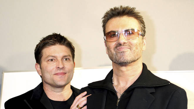 George Michael and former partner Kenny Goss in 2005