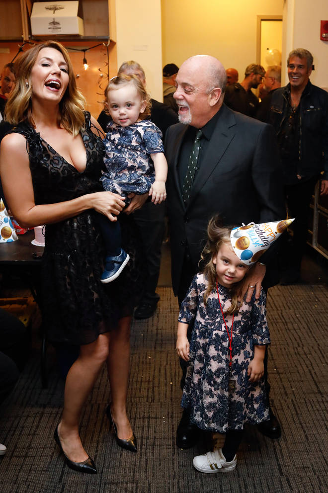 Billy Joel with wife Alexis and daughters Remy and Della in 2019