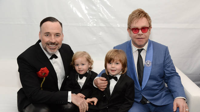Elton and David with their sons in 2015