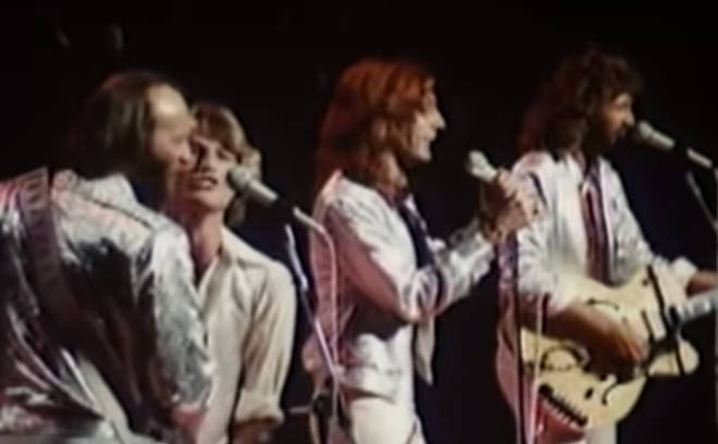 The 1979 performance came nine years before the Bee Gees would officially announce Andy Gibb would be joining them as the fourth member of the band in 1988.