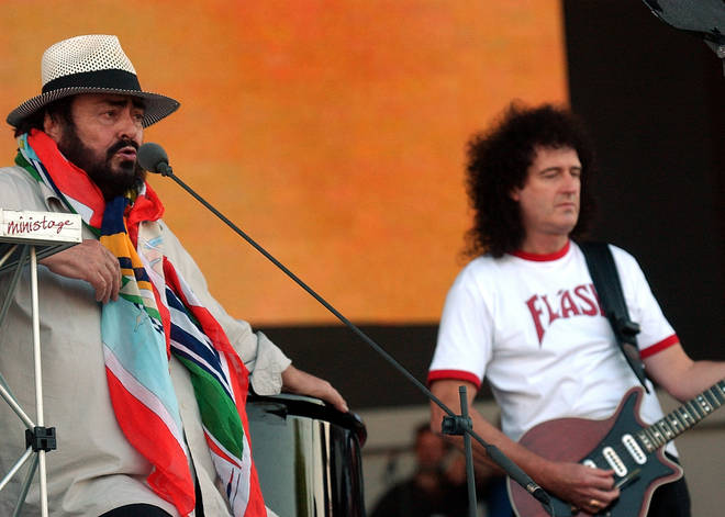 Pavarotti sings during a sound check session with Queen Guitarist Brian May to prepare for the Pavarotti and Friends 2003 concert May 25, 2003 in Modena, Italy.
