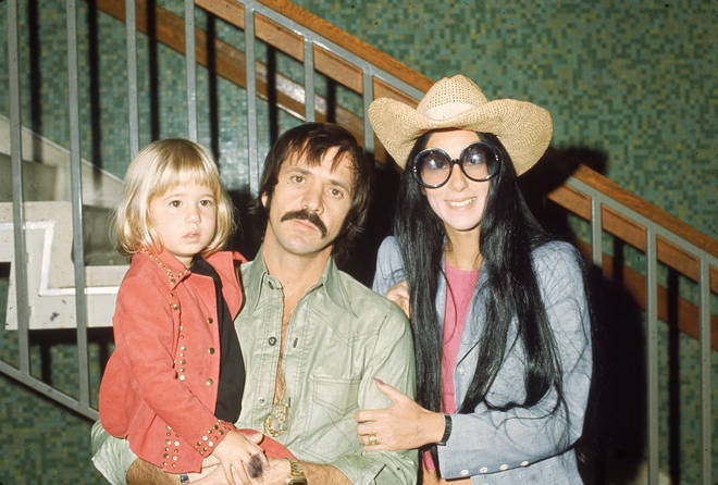 "Cher released her album Believe in 1998 and dedicated it to her ex-husband, with an inscription in its booklet reading ""In memory of Son"". (Pictured: Sonny, Cher and Chastity Bono in 1973)"