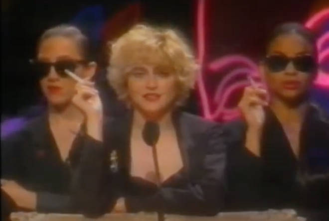 "Madonna, smoking a cigarette and accompanied by two smoking backing dancers, comes on stage to present the Video Vanguard Award to ""an artist who has made outstanding contributions to the world of music video."