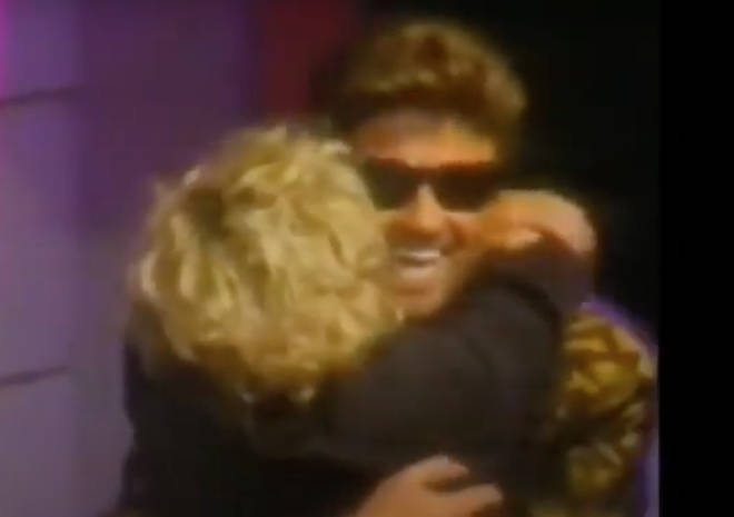 The singer himself then walks out on stage and after waving to the crowd immediately gives Madonna a huge bear hug, before approaching the podium.