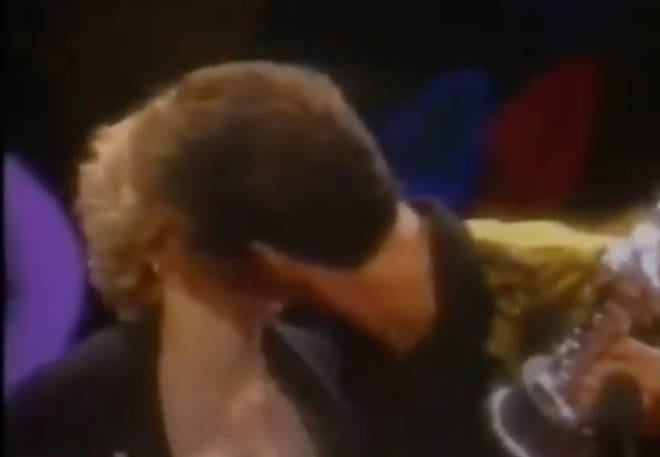 As the 'Like A Virgin' singer hands him the famous silver MTV astronaut statue, George leans forward and kisses Madonna gently on the lips as the audience scream.