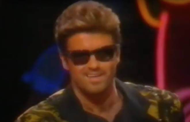 After the pair kiss, Madonna leaves the stage as George Michael starts to give his speech for the Lifetime Achievement Award.