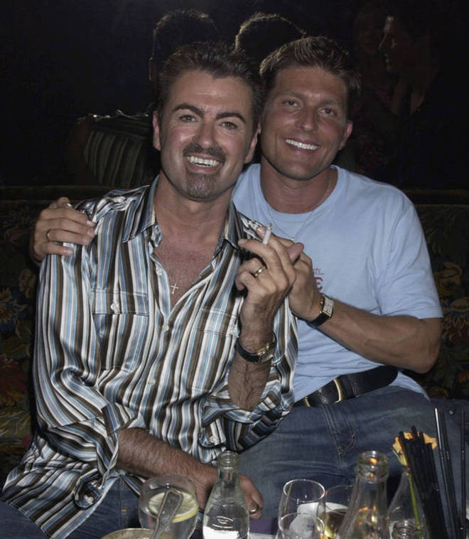 George Michael and partner Kenny Goss dated from 1996 to 2011. Pictured in 2002.