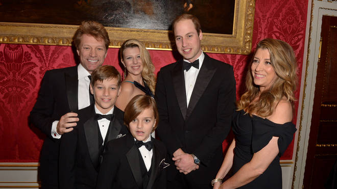 Prince William meets Jon Bon Jovi and wife Dorothea (right) with children (L-R) Jacob, Stephanie and Romeo in 2013