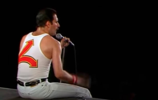 """Dressed in his trademark white jeans, tank top and white nike trainers, the Queen frontman spoke into his famous bottomless microphone stand, saying to the crowd: """"Ok everybody, let&squot;s play a game!"""""""